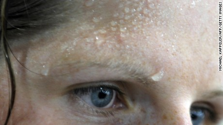 Sweat is seen on the forehead of German rowing athlete Christine Huth at the Gym at the Athlete's Olympic Village in Beijing on August 5, 2008, three days ahead of the start of the 2008 Beijing Olympic Games. The 2008 Beijing Olympic Games will take place in China between August 8 and 24.