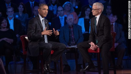 US President Barack Obama speaks at a town hall meeting with CNN's Anderson Cooper on reducing gun violence at George Mason University in Fairfax, Virginia, on January 7, 2016. Obama announced limited measures two days ago to tackle rampant US gun violence and called on Americans to punish lawmakers who oppose more meaningful reforms.   AFP PHOTO/ NICHOLAS KAMM / AFP / NICHOLAS KAMM        (Photo credit should read NICHOLAS KAMM/AFP/Getty Images)