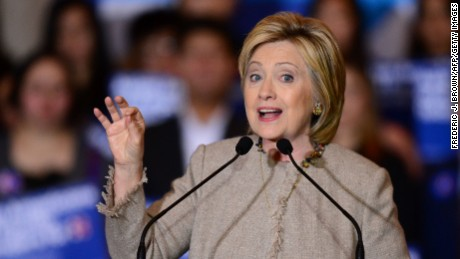 Democratic Presidential hopeful Hillary Clinton gestures while speaking with her supporters and Asian American and Pacific Islander (AAPI) elected officials, including Representative Judy Chu, Democrat-Pasadena, on January 7, 2016 in San Gabriel, California, to discuss what's at stake for the AAPI community.