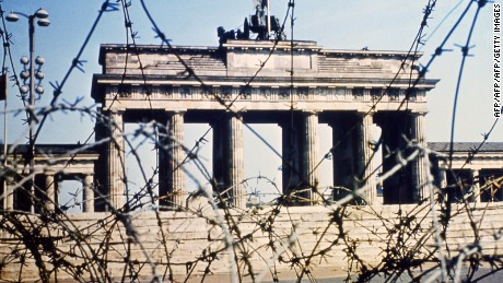 It's 1968, and Berlin's Brandenburg Gate is seen through a swirl of barbed wire.