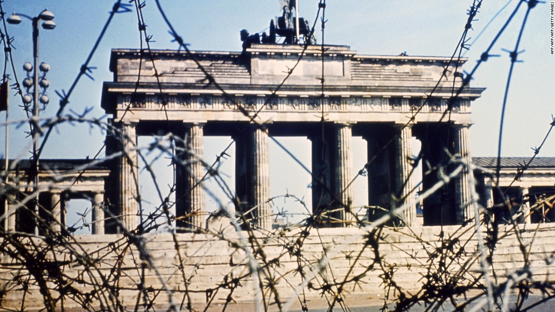 It's 1968, and Berlin's Brandenburg Gate is seen through a swirl of barbed wire. BFC came to represent football power in the east of the divided city.