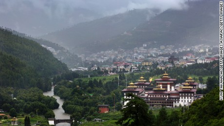 THIMPHU, BHUTAN - AUGUST 13: Tashichho dzong is seen in front of the main capital city Thimphu, Bhutan on Aug 13, 2014. It is the main secretariat building which houses the offices of the king. The central monastic body and some government ministries are also located in the dzong. (Photo by Kuni Takahashi/Getty Images)