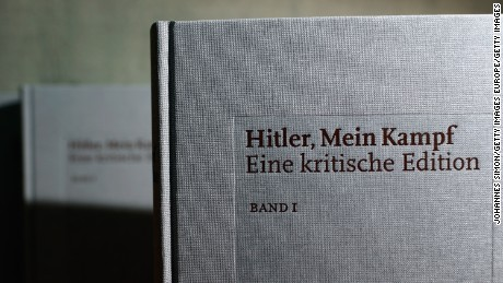 "MUNICH, GERMANY - JANUARY 08:  Copies of the new critical edition of Adolf Hitler's ""Mein Kampf"" are displayed prior to the book launch at the Institut fuer Zeitgeschichte (Institute for Contemporary History)on January 8, 2016 in Munich, Germany. The new edition, which augments Hitler's original text with critical analysis, is the first new publication of the book in Germany since World War II. The state of Bavaria held the copyright to the book and prohibited publication, though the copyright expired on January 1 of this year. Adolf Hitler wrote ""Mein Kampf"", which is both an autobiography and a presentation of his political views, while he was a prisoner in Germany in the 1920s.  (Photo by Johannes Simon/Getty Images)"