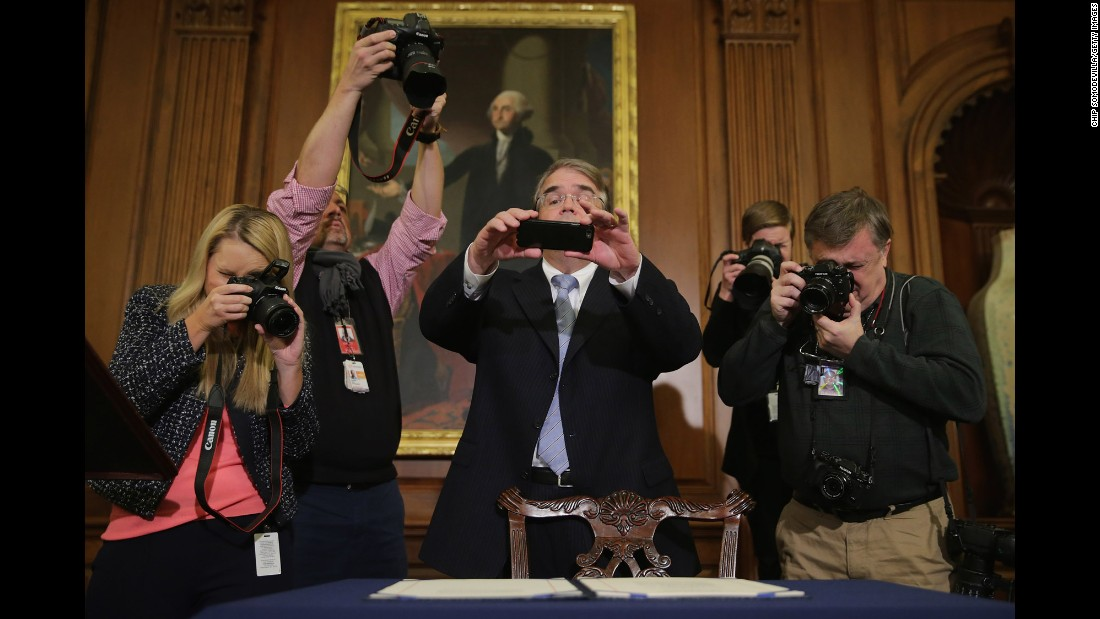 "Journalists and congressional staff members photograph legislation to repeal the Affordable Care Act, also known as Obamacare, and cut off federal funding of Planned Parenthood. The bill had just been signed by House Speaker Paul Ryan on Thursday, January 7. <a href=""http://www.cnn.com/2016/01/08/politics/obama-vetoes-obamacare-repeal-bill/index.html"" target=""_blank"">President Obama vetoed the bill</a> the next day."