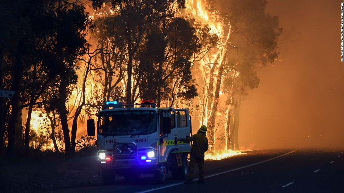 Images from Western Australia emergency services show towering flames dwarfing vehicles as firefighters race to control the blaze.