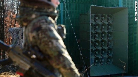 A South Korean soldier stands near the loudspeakers near the border area between South Korea and North Korea in Yeoncheon, South Korea, Friday.