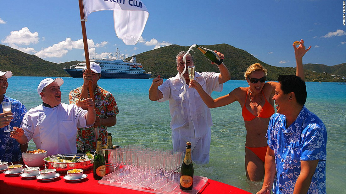 Less of a cruise, more of a luxury yachting experience, SeaDream offers its guests a sumptuous farewell beachside barbecue. The meat is served poolside on bone china while guests can fill up on caviar and champagne served on a surfboard.