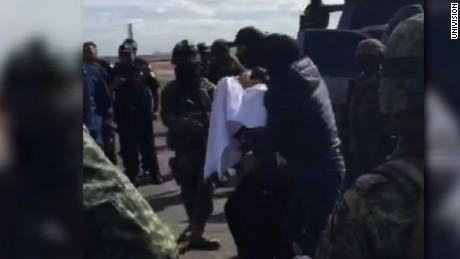 """""""EL CHAPO"""" ESCORTED BY POLICE INTO JET"""