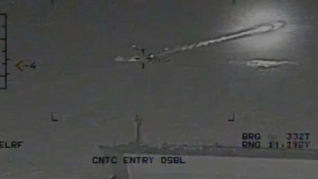 See Iranian rocket fly by U.S. carrier