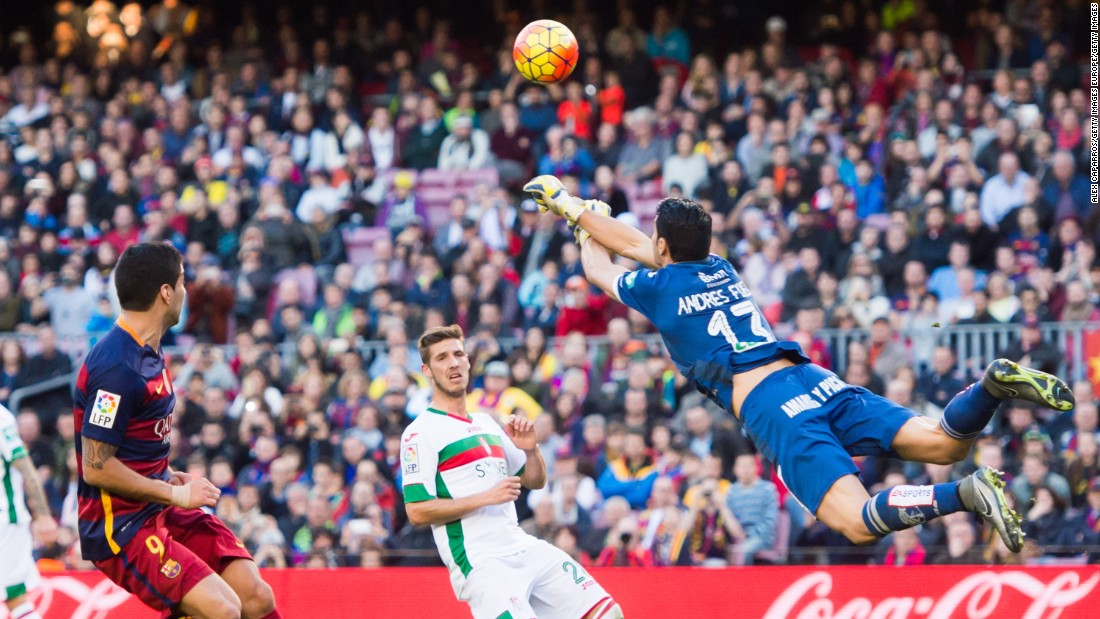 It was a tough day for Granada keeper,  Andres Fernandez of Granada CF, pictured here clearing the ball away from Luis Suarez (L) of Barcelona.