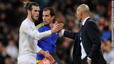Hat trick scorer Gareth Bale of Real Madrid shakes hands with Zinedine Zidane manager of Real Madrid as he is substituted during the La Liga match between Real Madrid CF and RC Deportivo La Coruna at Estadio Santiago Bernabeu on January 9, 2016 in Madrid, Spain.