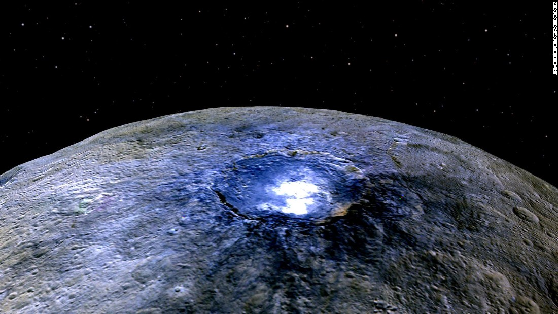 "Ceres has <a href=""https://www.nasa.gov/feature/jpl/dawn/new-clues-to-ceres-bright-spots-and-origins"" target=""_blank"">more than 130 bright spots</a>, according to NASA. This false color image shows one of spots -- this one in a crater called Occator. Scientists say the substance appears to be a type of magnesium sulfate called hexahydrite. Scientists use false color to help study differences in surface materials, NASA says."