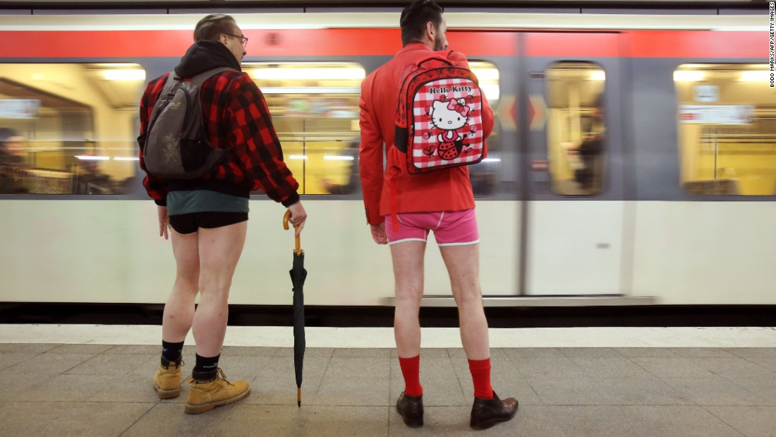 Men without pants wait for a train at a subway station in Hamburg, Germany.