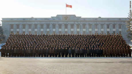 North Korean leader Kim Jong Un poses with workers who contributed to the H-bomb test, reports KCNA.