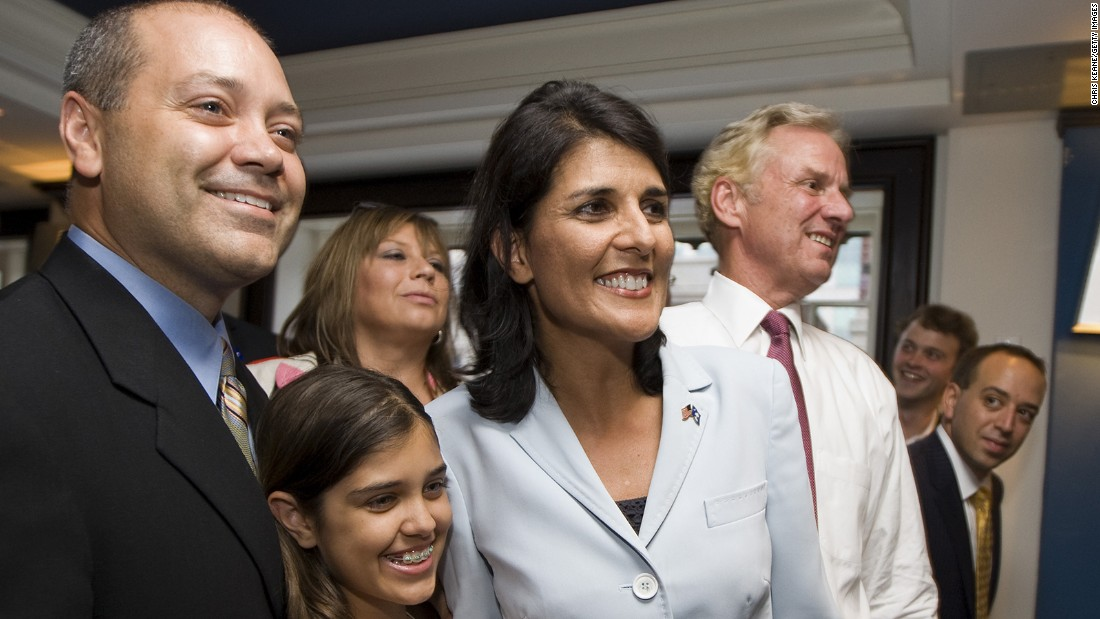 Gubernatorial candidate Nikki Haley smiles along with her husband, Michael Haley, left, and daughter Rena as they watch the Republican runoff results at the Columbia Sheraton on June 22, 2010, in Columbia, South Carolina. Haley defeated Rep. Gresham Barrett in the Republican runoff.