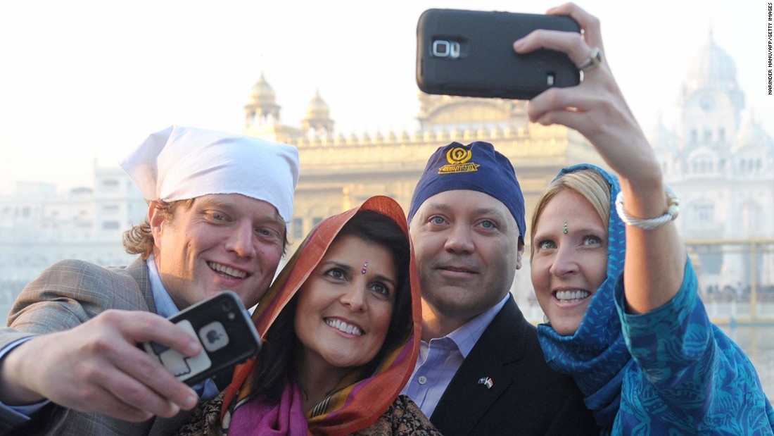 Haley and her husband pose as they take selfies at the Golden Temple in Amritsar, India, on November 15, 2014.