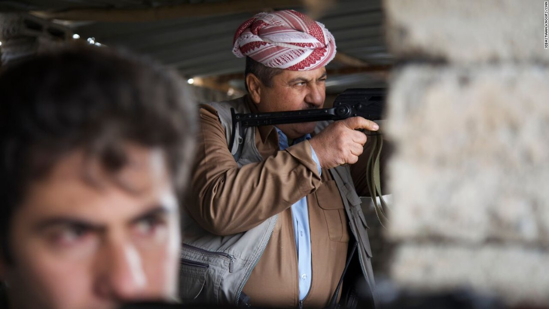 Peshmerga fighters train their guns on the front line in northern Iraq, which children try to reach after fleeing ISIS.