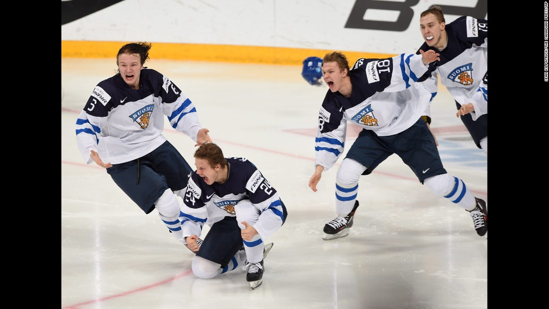 Finnish hockey players celebrate after Kasperi Kapanen, second from left, scored the game-winning overtime goal to beat Russia and win the World Juniors on Tuesday, January 5. The tournament took place in Helsinki, Finland.