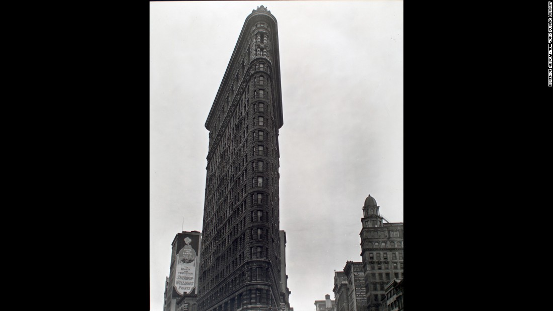 The 22-story Flatiron Building looms skyward on Fifth Avenue and 23rd Street in 1938. The building was considered groundbreaking at its completion in 1902, and it was one of the tallest buildings in the city.