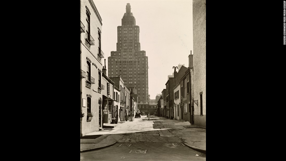 A few blocks down, between Eighth Street and Washington Square, a man in an apron walks through MacDougal Alley in 1936.