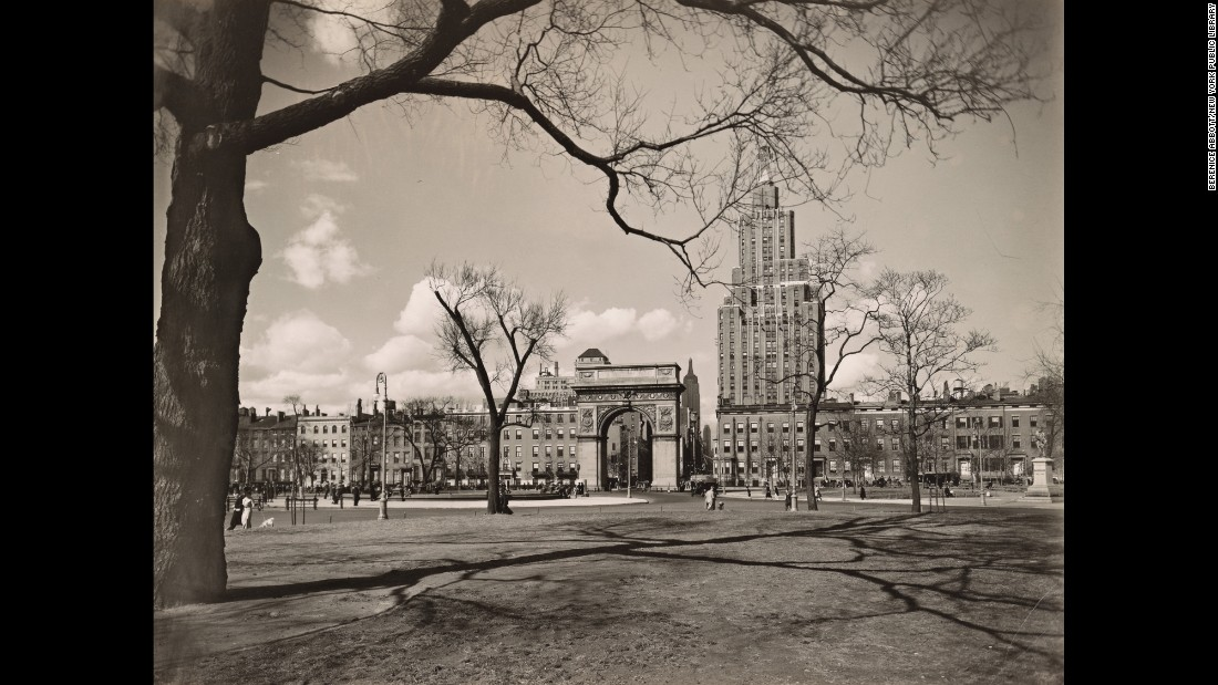 The Empire State Building is seen in the distance in this photo looking north into Washington Square in 1936.