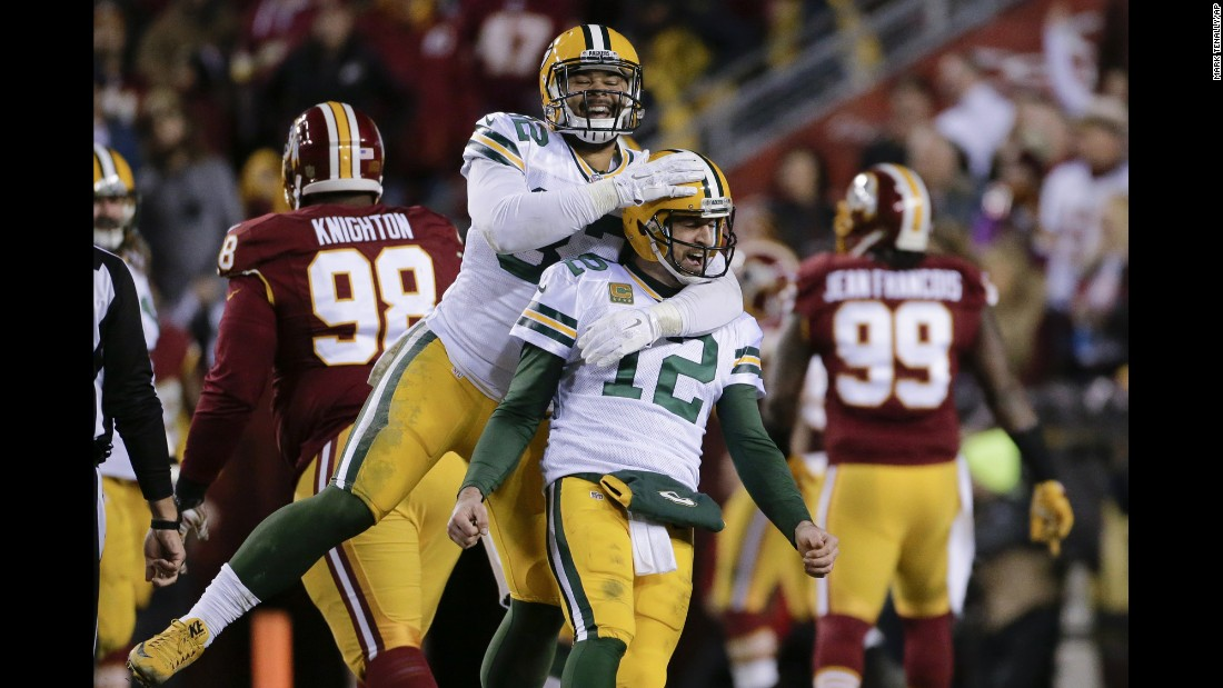 Green Bay tight end Richard Rodgers embraces quarterback Aaron Rodgers -- no relation -- after a touchdown against Washington on Sunday, January 10. Green Bay won 35-18 to advance to the next round of the NFL playoffs.
