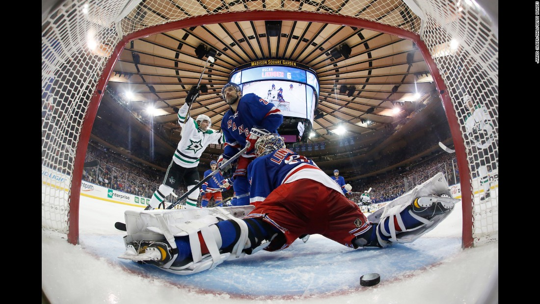 Dallas forward Patrick Sharp, left, celebrates as a shot from Antoine Roussel slips past New York Rangers goalie Henrik Lundqvist during an NHL game in New York on Tuesday, January 5. The Rangers still won the game 6-2.