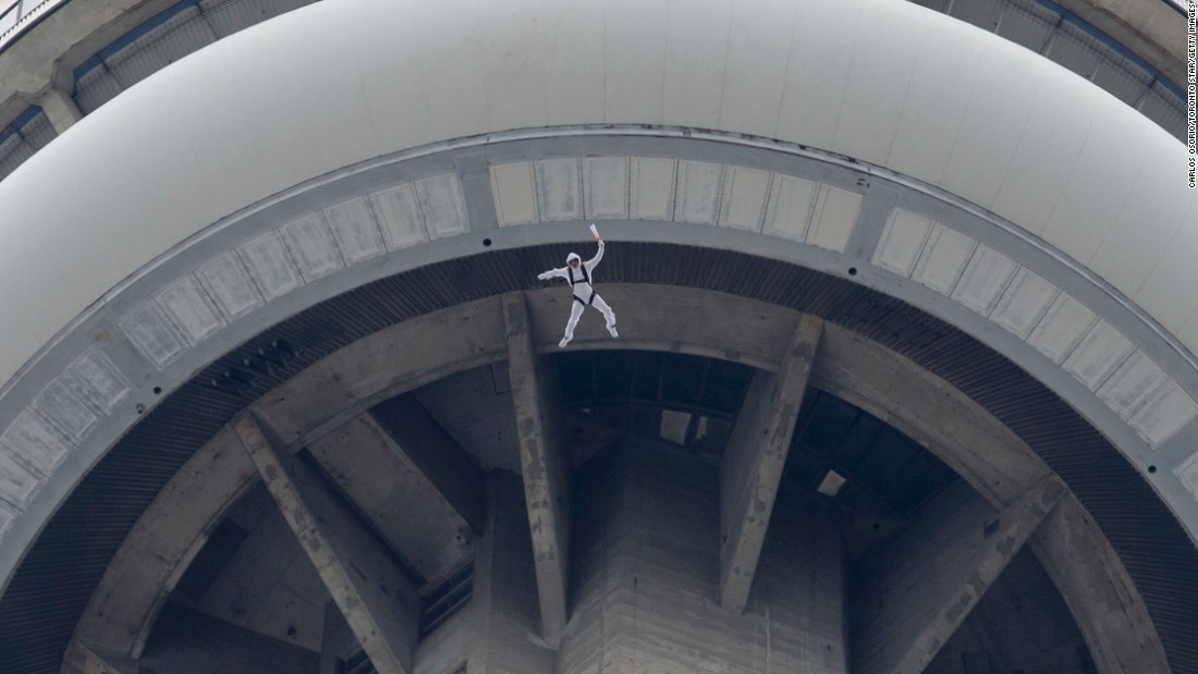 "BASE jumper Fred Fugen, from Red Bull's Soul Flyers team, leaps from Toronto's 1,815-foot <a href=""http://www.cnn.com/2013/10/03/world/cn-tower-fast-facts/"">CN Tower </a>in May."