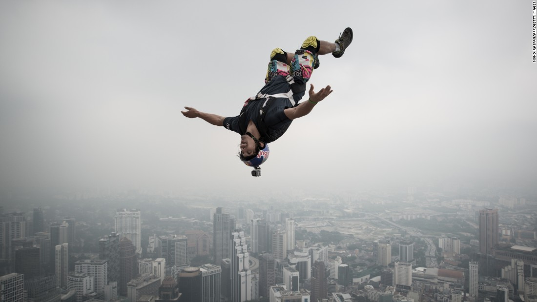 French jumper Vince Reffet leaps from the 920-foot-tall open deck of the Kuala Lumpur Tower during the annual International Tower Jump in September 2013.