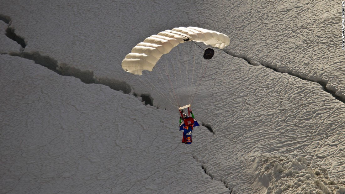 Valery Rozov prepares for landing after a wingsuit jump from the Grand Pilier d'Angle, a nearly 14,000-foot-tall buttress on the southern side of Mont Blanc in July 2011.