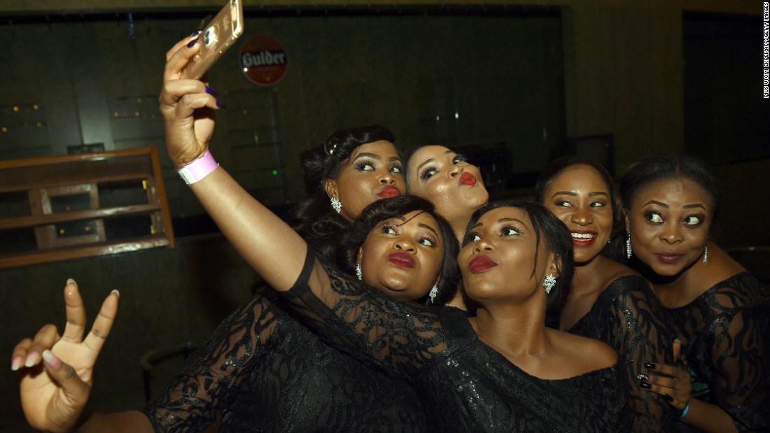 Hostesses take a selfie in Abuja, Nigeria, where Pierre-Emerick Aubameyang received the African Footballer of the Year Award on Thursday, January 7.