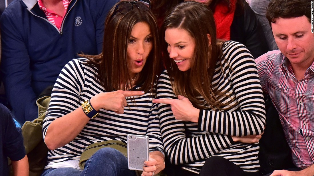 Actresses Mariska Hargitay, left, and Hilary Swank attend a New York Knicks basketball game on Sunday, January 10.