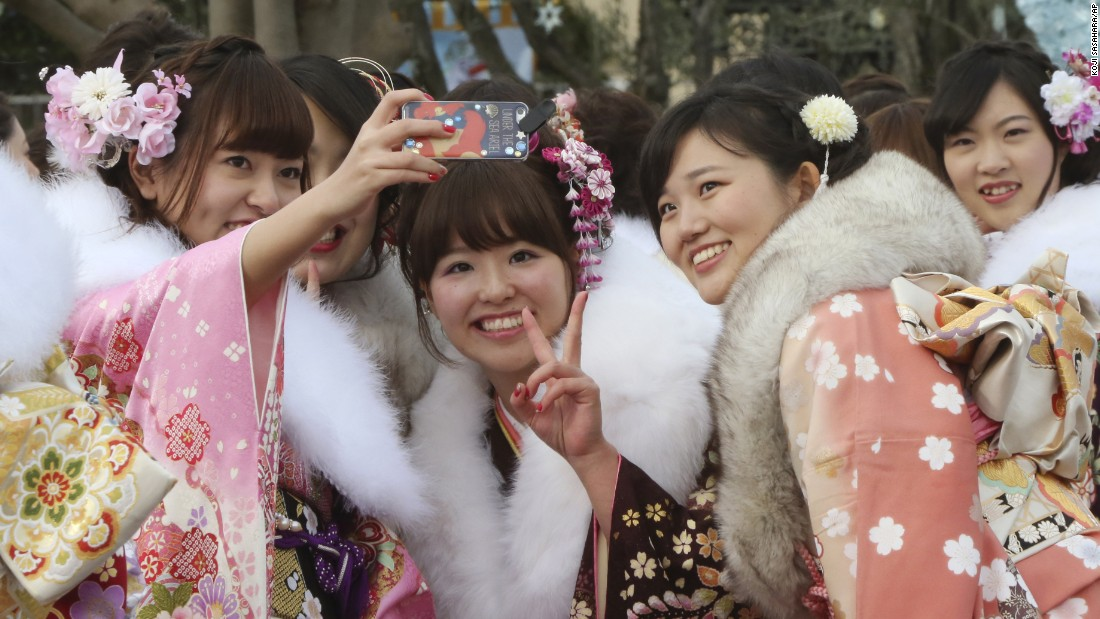 Women take a selfie at Tokyo Disneyland on Monday, January 11.