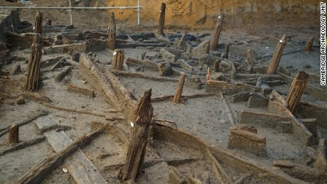 Bronze Age piles preserved within the river silts and collapsed structural timbers.
