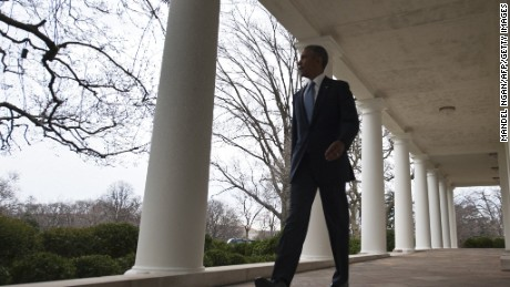 US President Barack Obama walks through the Colonnade from the Oval Office on January 12, 2016 in Washington, DC. Obama will deliver his final State of the Union Address later January 12.