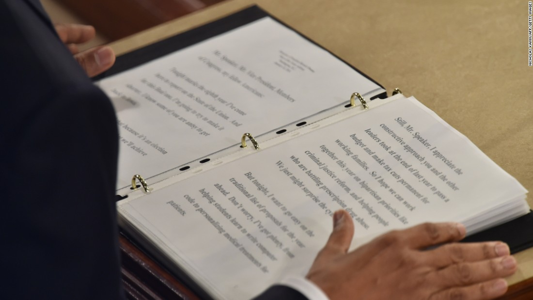 Obama reads from the text of his State of the Union address.