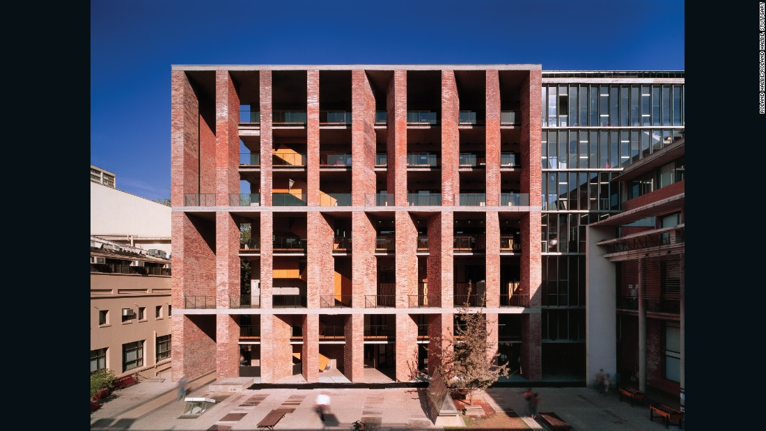 """We were asked to do all kinds of classrooms, from seminars to auditoriums, in a very dense context. The only way out, was to go high. Given that massive student occupancy in higher floors has always been hard to solve, we decided to bring the courtyard closer to each upper floor. This building is a vertical cloister."""
