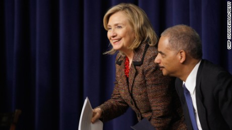 Secretary of State Hillary Clinton and Attorney General Eric Holder participate an event on May 16, 2011, in Washington.