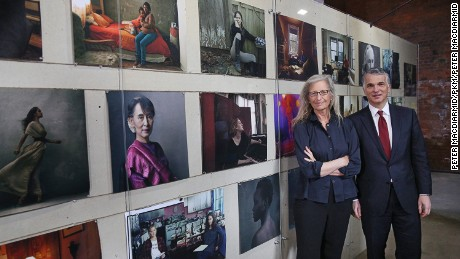 Annie Leibovitz stands with Sergio P Ermotti, Group CEO, UBS at the launch of the 'WOMEN:New Portraits' exhibition at Wapping Hydraulic Power Station.