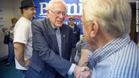 Democratic presidential candidate Sen. Bernie Sanders, seen here shaking hands, shares the same economic philosophy as the Rev. Martin Luther King, Jr., some say.