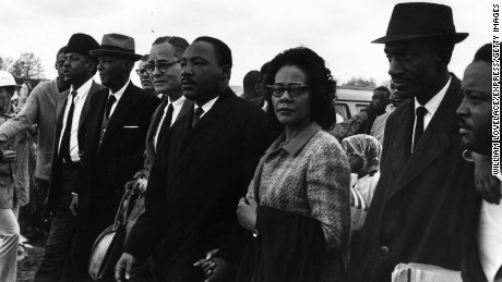 King joins his wife,  Coretta Scott King, during a march from Selma, Alabama, to the state capital in Montgomery in 1965.