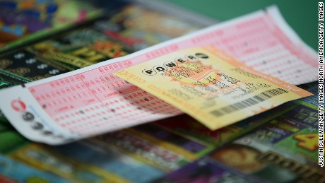 SAN LORENZO, CA - JANUARY 13:  A Powerball ticket sits on the counter at Kavanagh Liquors on January 13, 2016 in San Lorenzo, California. Dozens of people lined up outside of Kavanagh Liquors, a store that has had several multi-million dollar winners, to -purchase Powerball tickets in hopes of winning the estimated record-breaking $1.5 billion dollar jackpot.  (Photo by Justin Sullivan/Getty Images)