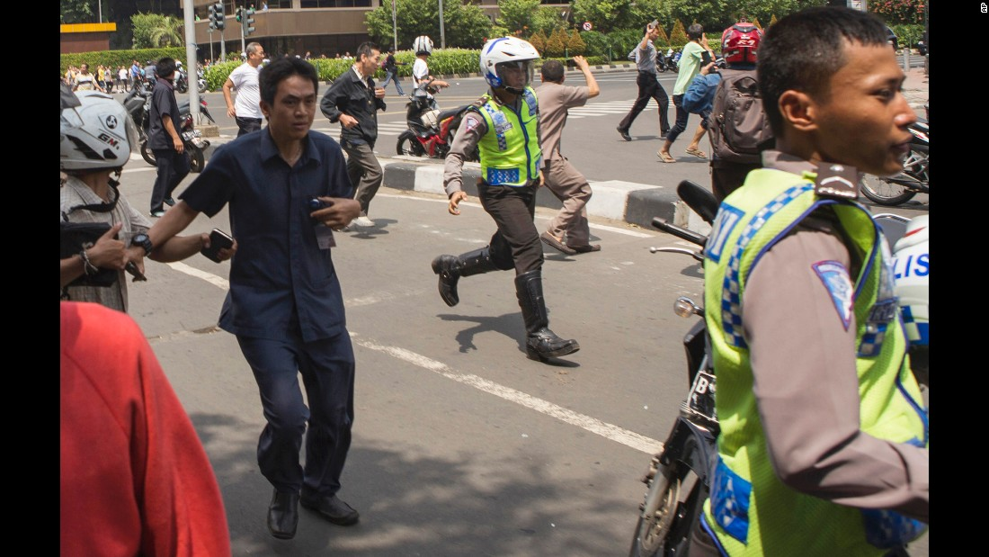 "People flee the scene of <a href=""http://www.cnn.com/2016/01/14/asia/gallery/jakarta-gunfire-explosions/index.html"" target=""_blank"">an attack in Jakarta, Indonesia,</a> on Thursday, January 14. The militant group ISIS claimed responsibility for the attack, which killed at least two people and wounded 19 in a busy commercial hub."