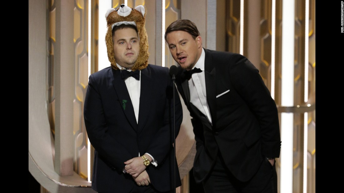 "Actors Jonah Hill, left, and Channing Tatum present an award at the Golden Globes on Sunday, January 10. Hill said he was the bear from ""The Revenant,"" which won best motion picture in the drama category. <a href=""http://www.cnn.com/2016/01/10/entertainment/gallery/golden-globes-2016-winners/index.html"" target=""_blank"">See all the winners</a>"