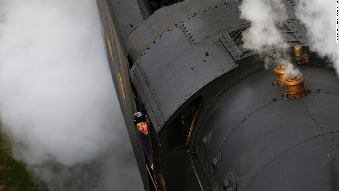 A man looks out from the footplate of The Flying Scotsman steam engine as it leaves Bury, England, on Friday, January 8. The Scotsman was recently restored more than 80 years after becoming the first locomotive to reach 100 mph.