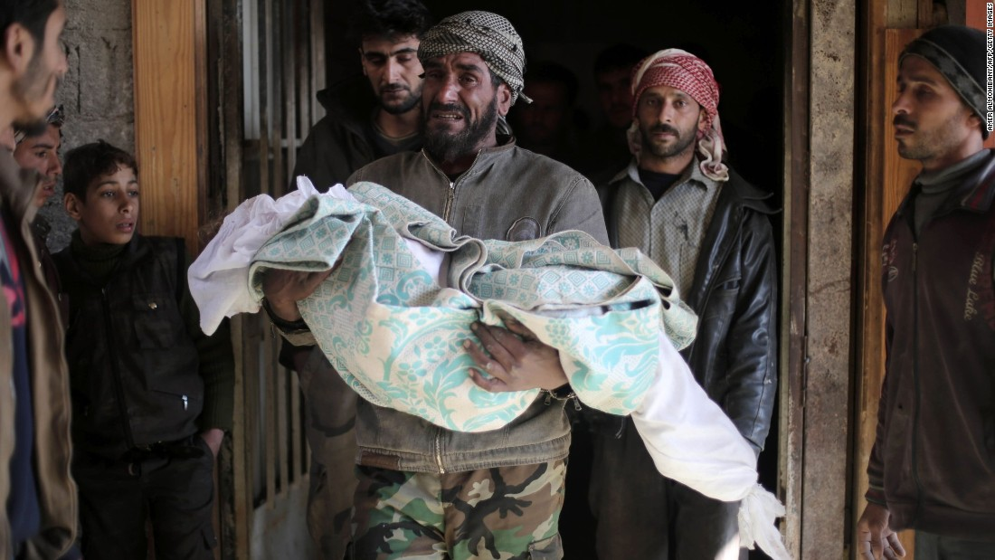 "A man carries the body of his 10-year-old daughter before her funeral in Deir al-Asafir, Syria, on Tuesday, January 12. She was reportedly killed in airstrikes that hit a kindergarten. <a href=""http://www.cnn.com/2015/05/22/world/gallery/syria-civil-war-pictures/index.html"" target=""_blank"">Syria's civil war in pictures</a>"