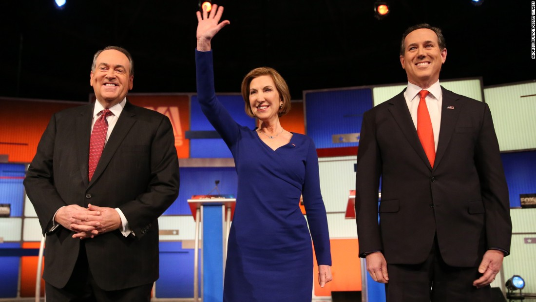 "From left, Republican presidential candidates Mike Huckabee, Carly Fiorina and Rick Santorum arrive for the ""undercard"" debate that took place a couple of hours before the main event."