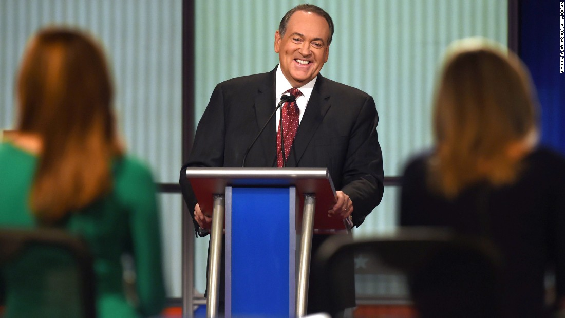 "Huckabee laughs during the debate, which was hosted by the Fox Business Network. His opening statement was much more serious. ""There are a lot of people who are hurting today,"" said the former Arkansas governor. ""I wish the President knew more of them. He might make a change in the economy and the way he's managing it."""
