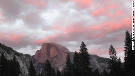 A view of Half Dome from Cook's Meadow at Yosemite National Park shows the colors at sunset. The park was created on October 1, 1906.