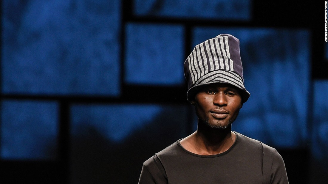 Three African asylum seekers took to the runway this week at Pitti Immagine Uomo 89. Here, one model walks for African-designed fashion brand U.mi-1.